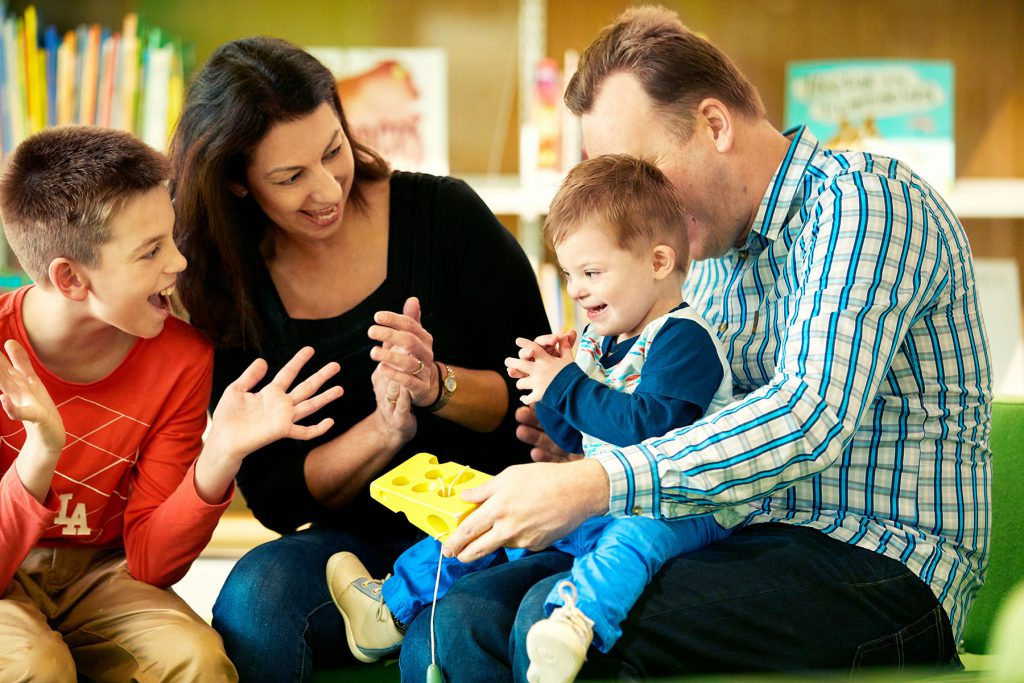 Happy family playing and clapping at Kalparrin Centre
